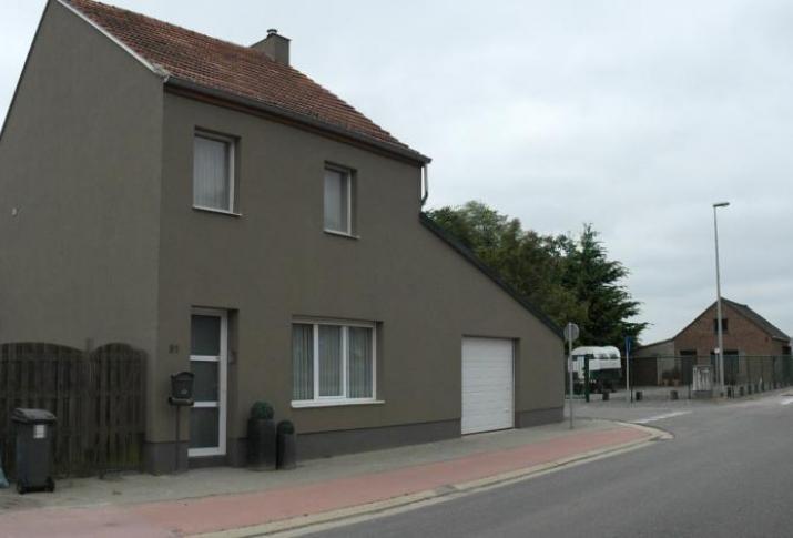 Oude woning opgefrist via bepleistering